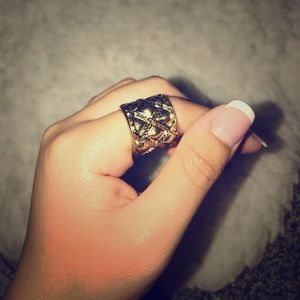 Woven, intricate gold ring